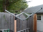 Fold-out clothesline